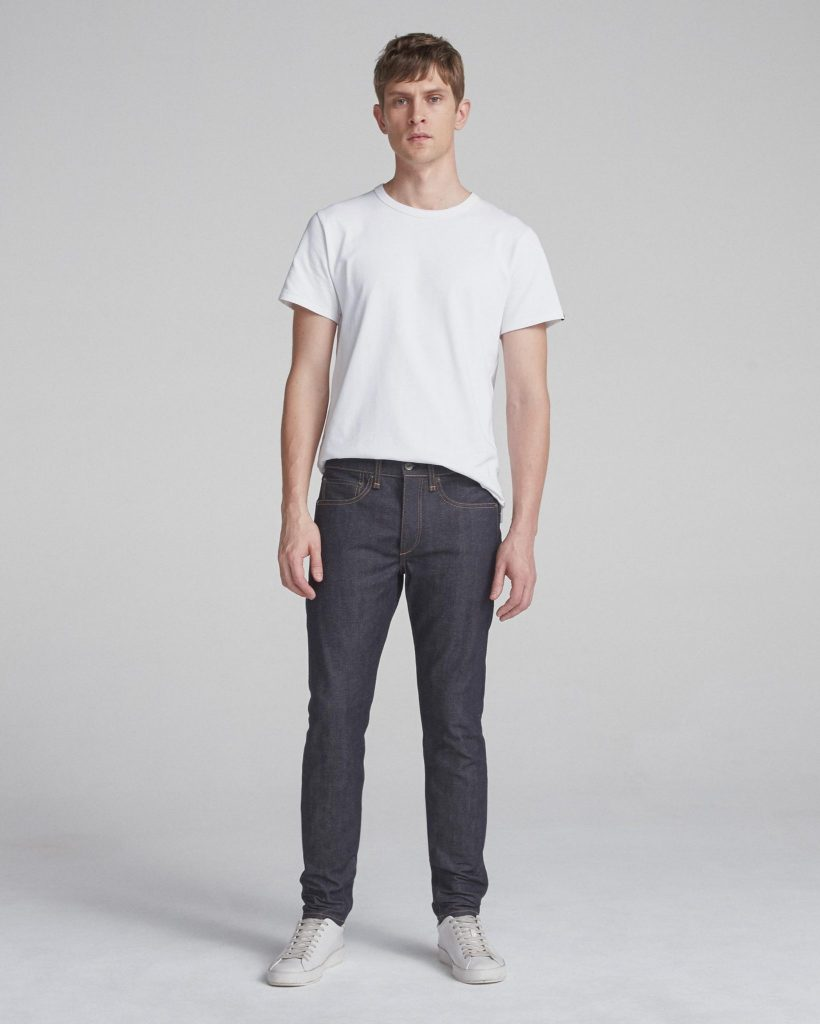 rag and bone male model wearing blue jeans and a white t-shirt