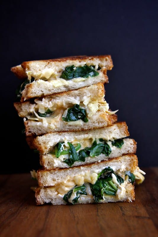 Spinach and artichoke grilled cheese cut in half