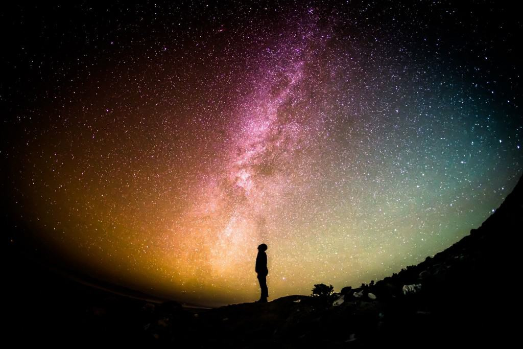 Boy looking up at starry sky. astronomy is a great father son activity